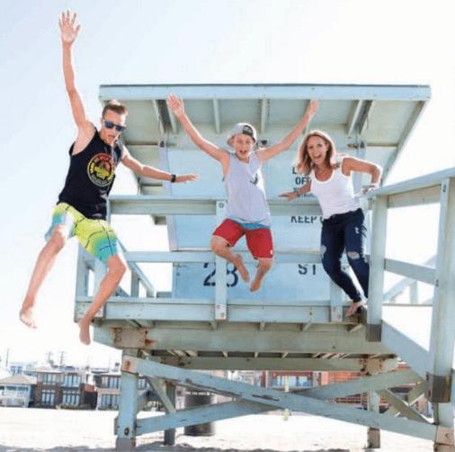 family jumping at hermosa beach