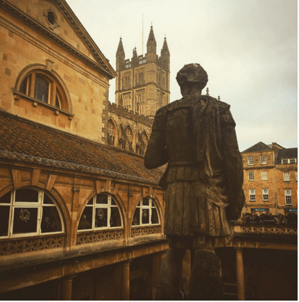The Roman Baths and statues in Bath, England