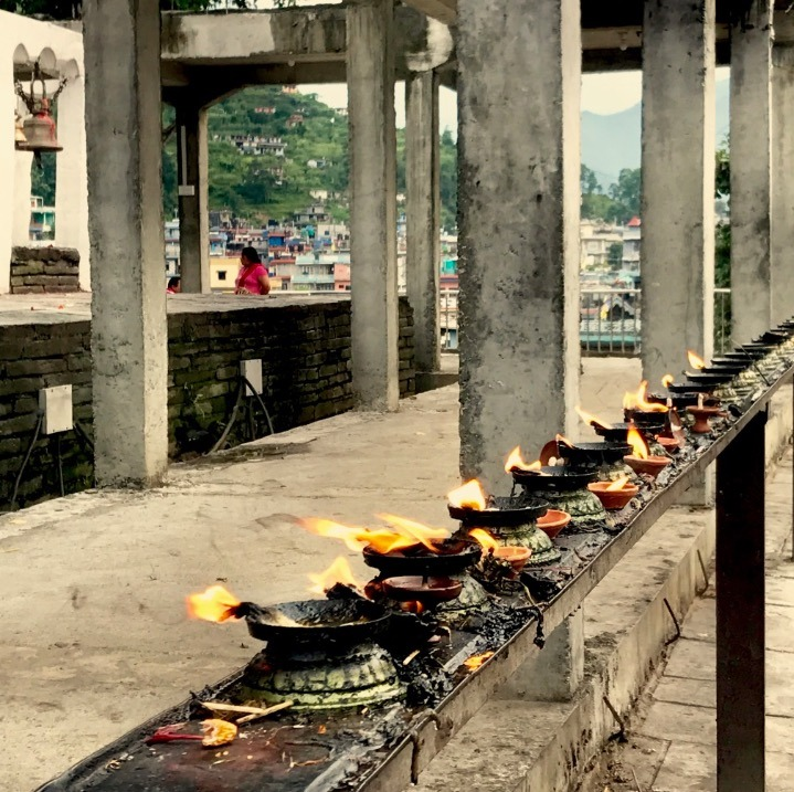 travel to pokhara nepal with kids prayer bowls