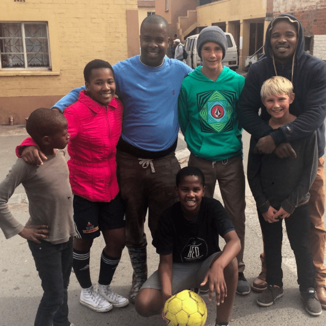 playing soccer with kids in Africa