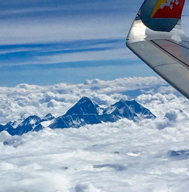 mount everest poking through the clouds en route to Paro