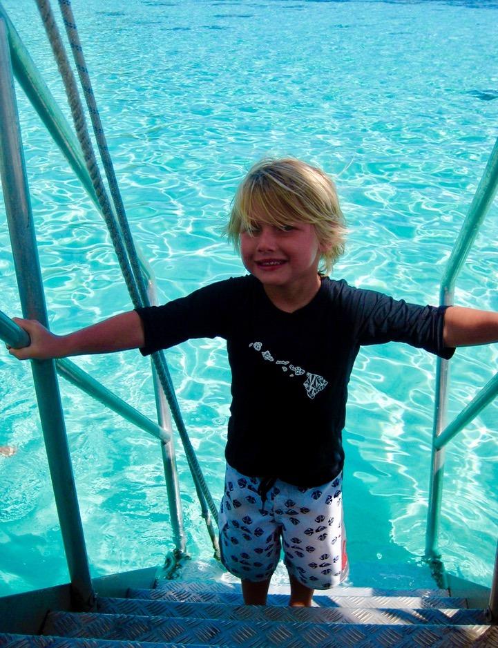 kids who swimming with sharks Moorea tahiti with kids