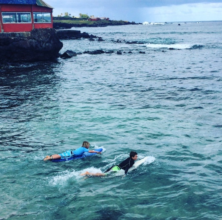 surfing on easter island with kids