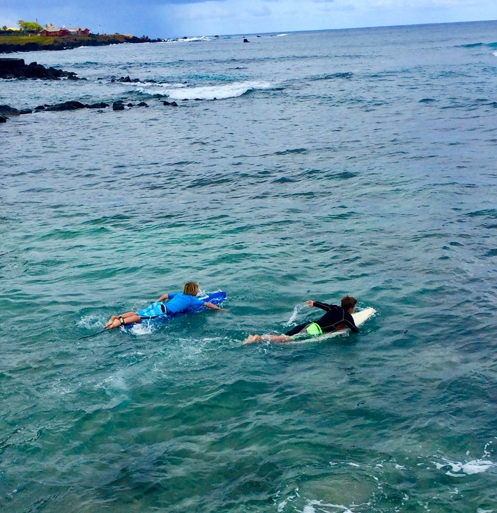 kids surfing on easter island