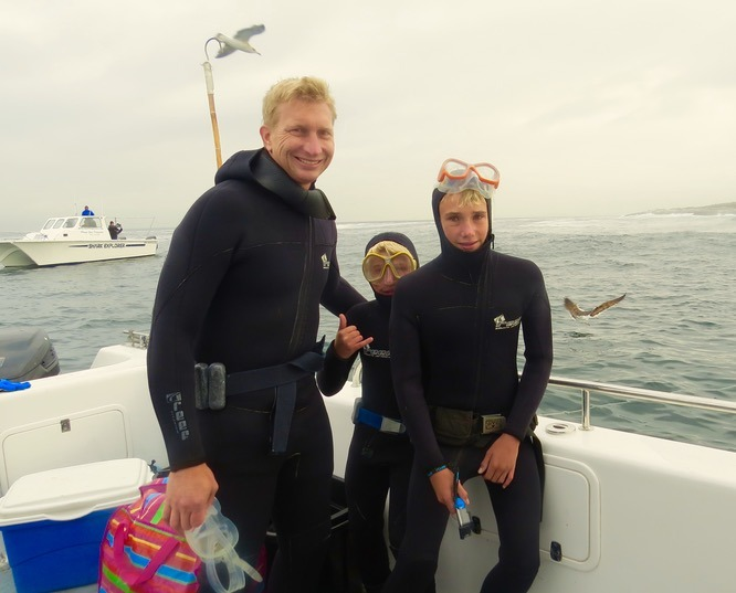 kids whi shark diving in cages in south africa