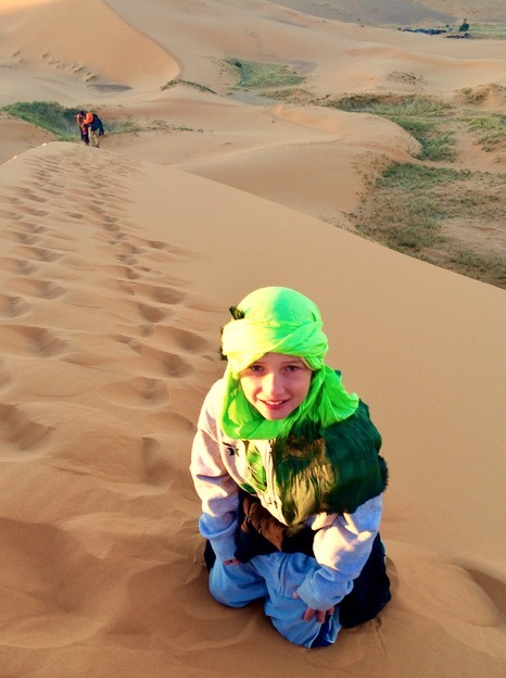 climbing dunes in the sahara desert, Morocco