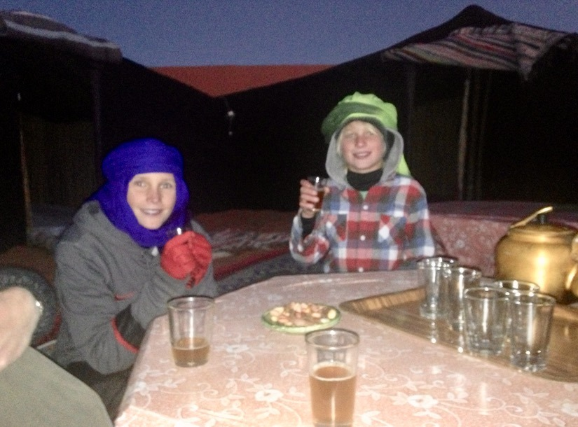 kids drinking tea in the sahara desert, Morocco