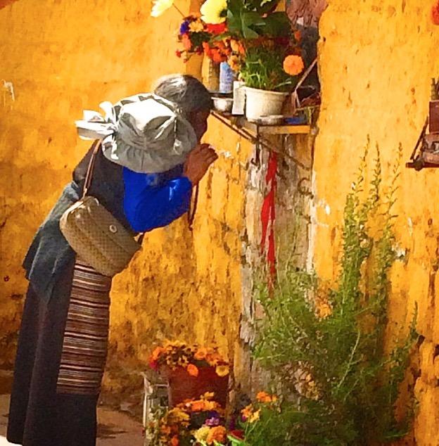Lhasa Tibet praying lady