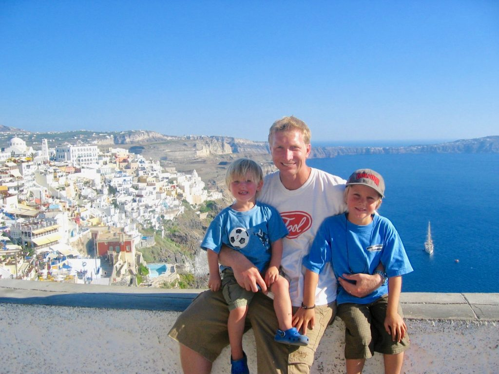 santorini greece, the family looking over the caldera