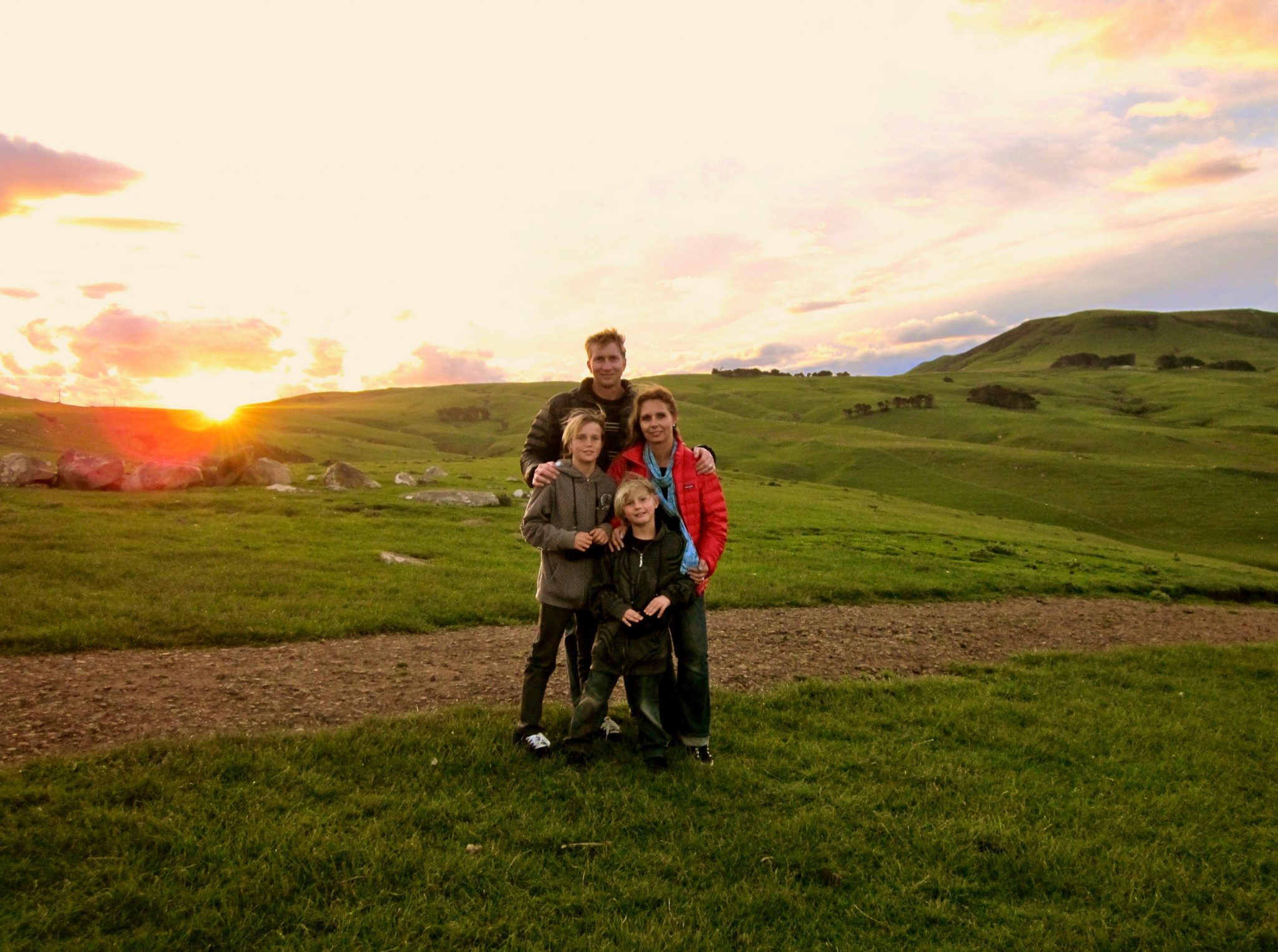 family at sunset dunedin new zealand