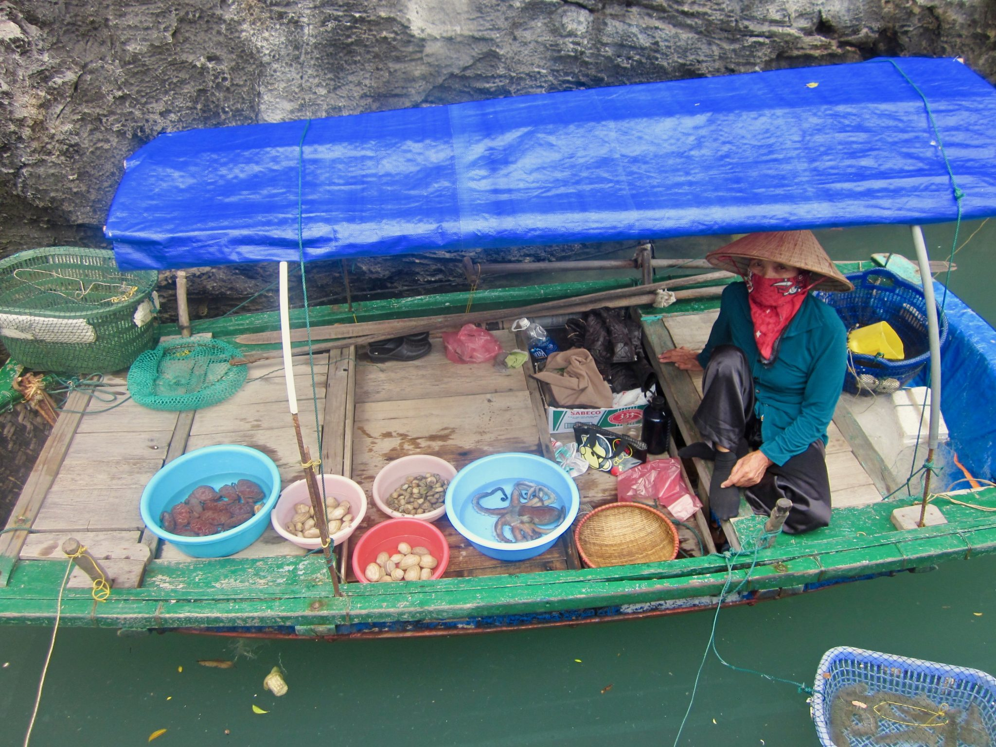 Buy your fish from floating fish markets in Halong Bay Vietnam