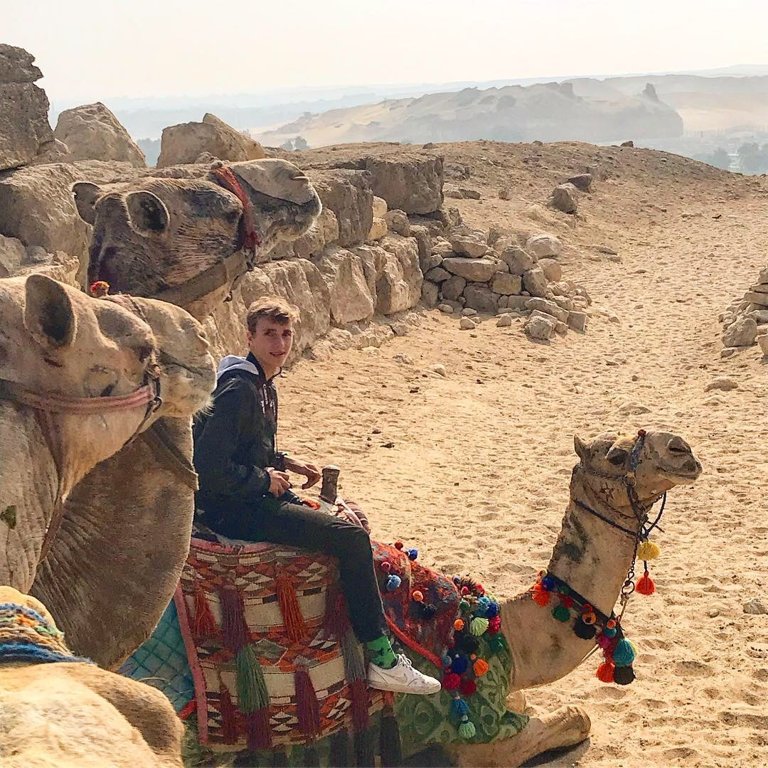pyramids of giza in cairo egypt riding camels