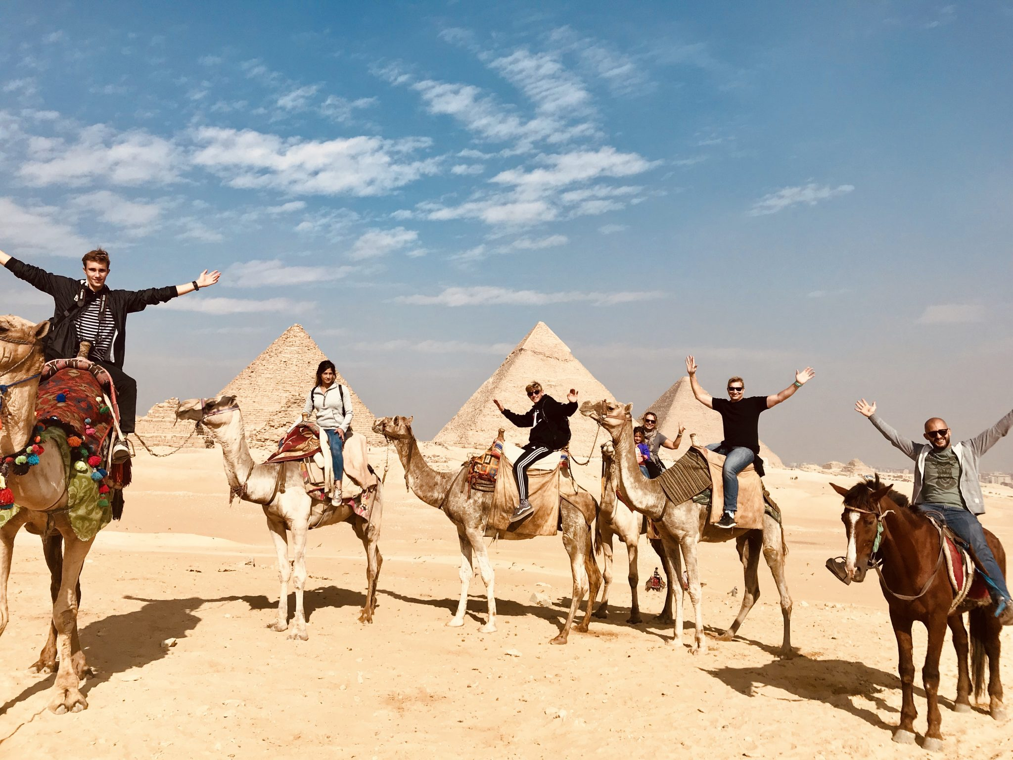 pyramids of giza on camels in cairo