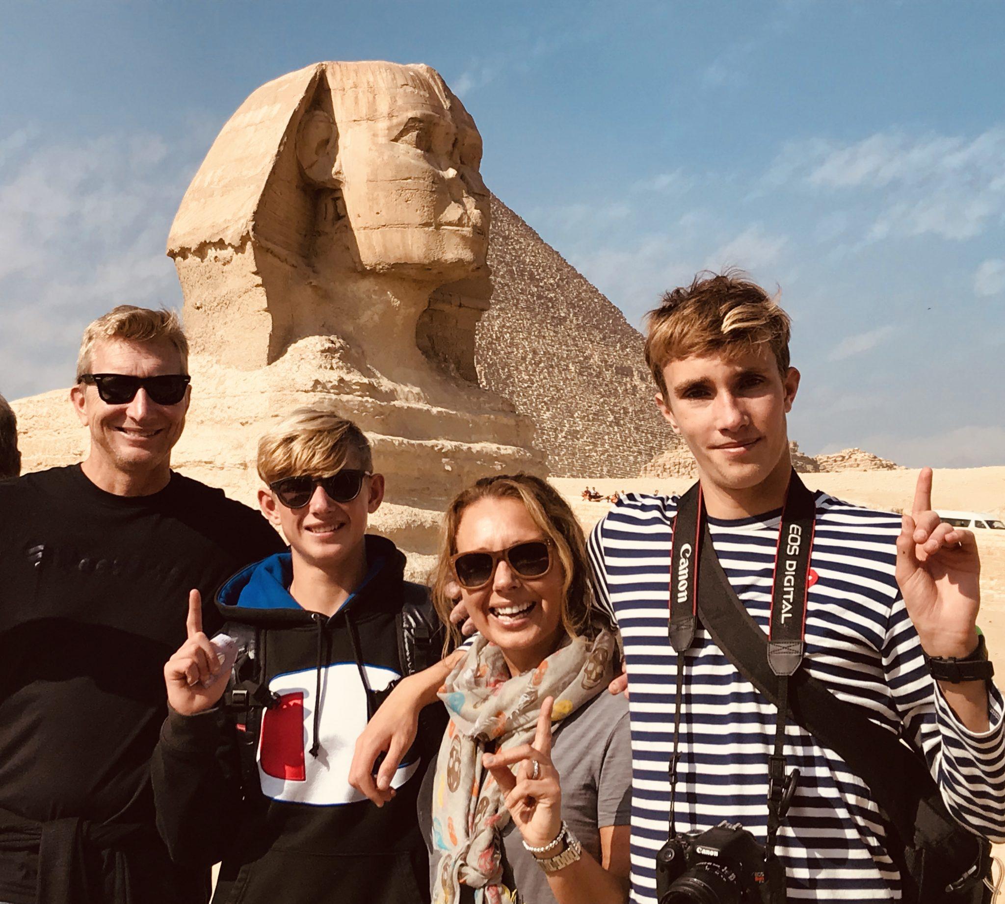 sphinx in cairo, pyramids of giza in egypt wiht family