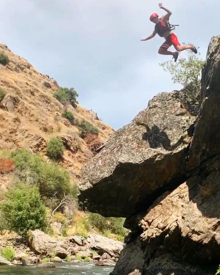 jumping off rocks on white water rafting trip