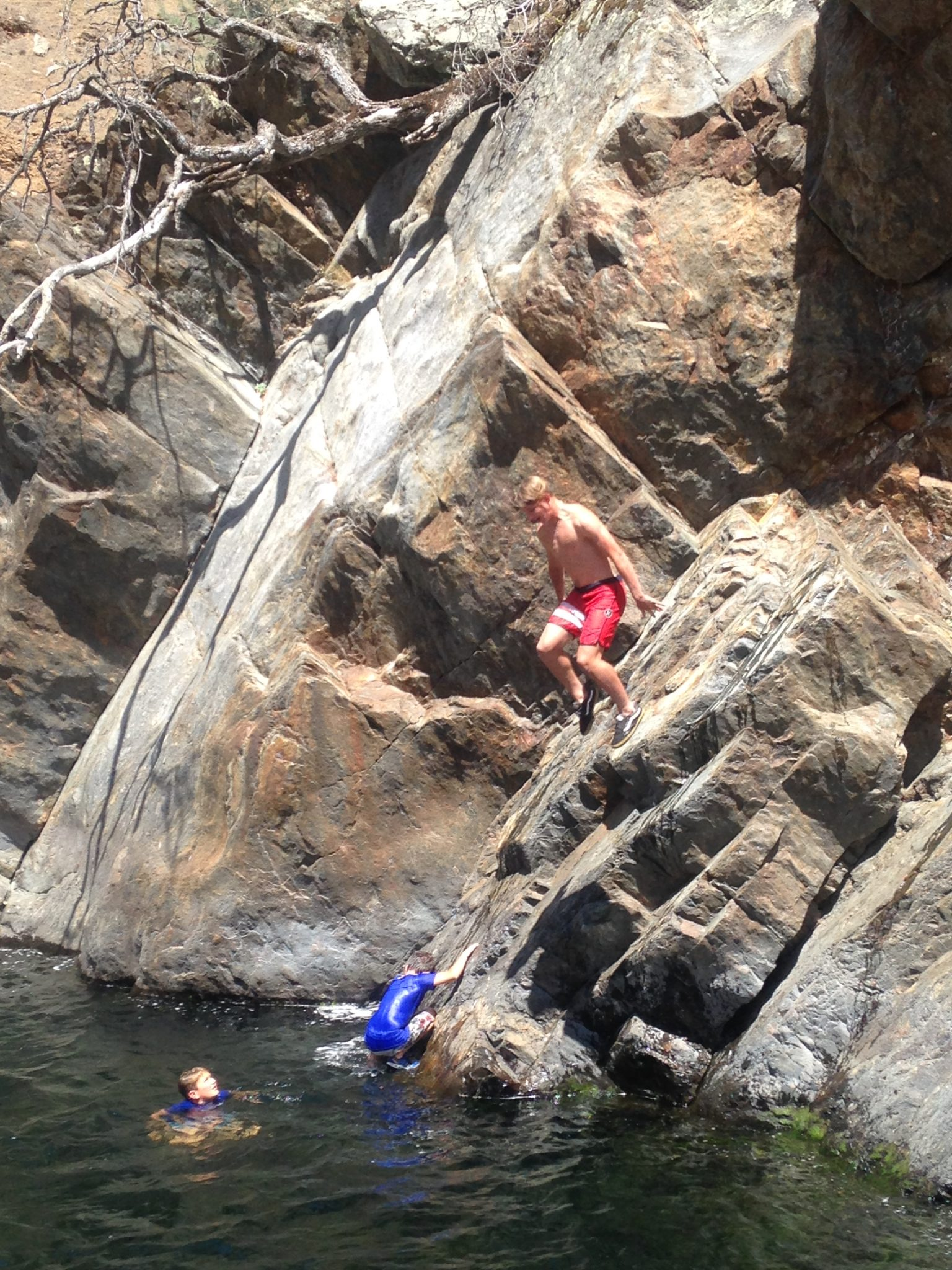 jumping off rocks int he tuolomne river yosemite