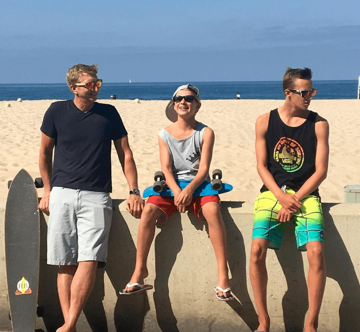 sitting on the pier - samantha kuhr in hermosa beach with her family
